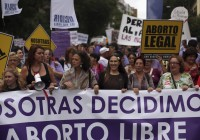 Demonstrators shout slogans during pro-choice protest against government's proposed new abortion law in Madrid
