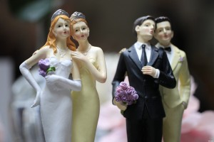Same-sex couple plastic figurines are displayed during a gay wedding fair in Paris