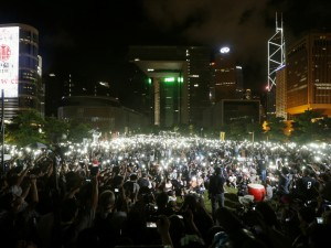 Pro-democracy protesters switch on their mobile phones during a campaign to kick off the Occupy Central civil disobedience event in Hong Kong