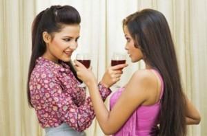 Lesbian couple drinking wine