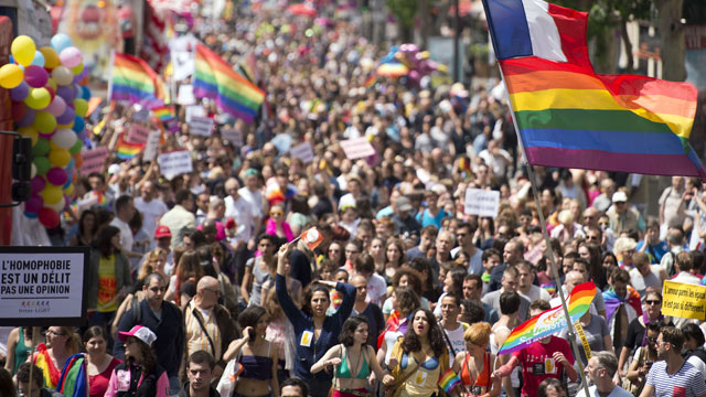 Paris street's full for first Gay Pride since legalisation of gay marriage - video